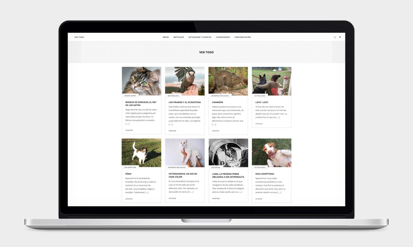 presentación de diseño de magazine electrónico dedicado a los animales y la naturaleza presentado en un portátil sección categorías