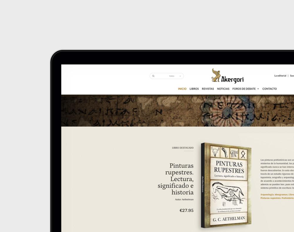 presentación diseño tienda online de libros Editorial Akergori en laptop