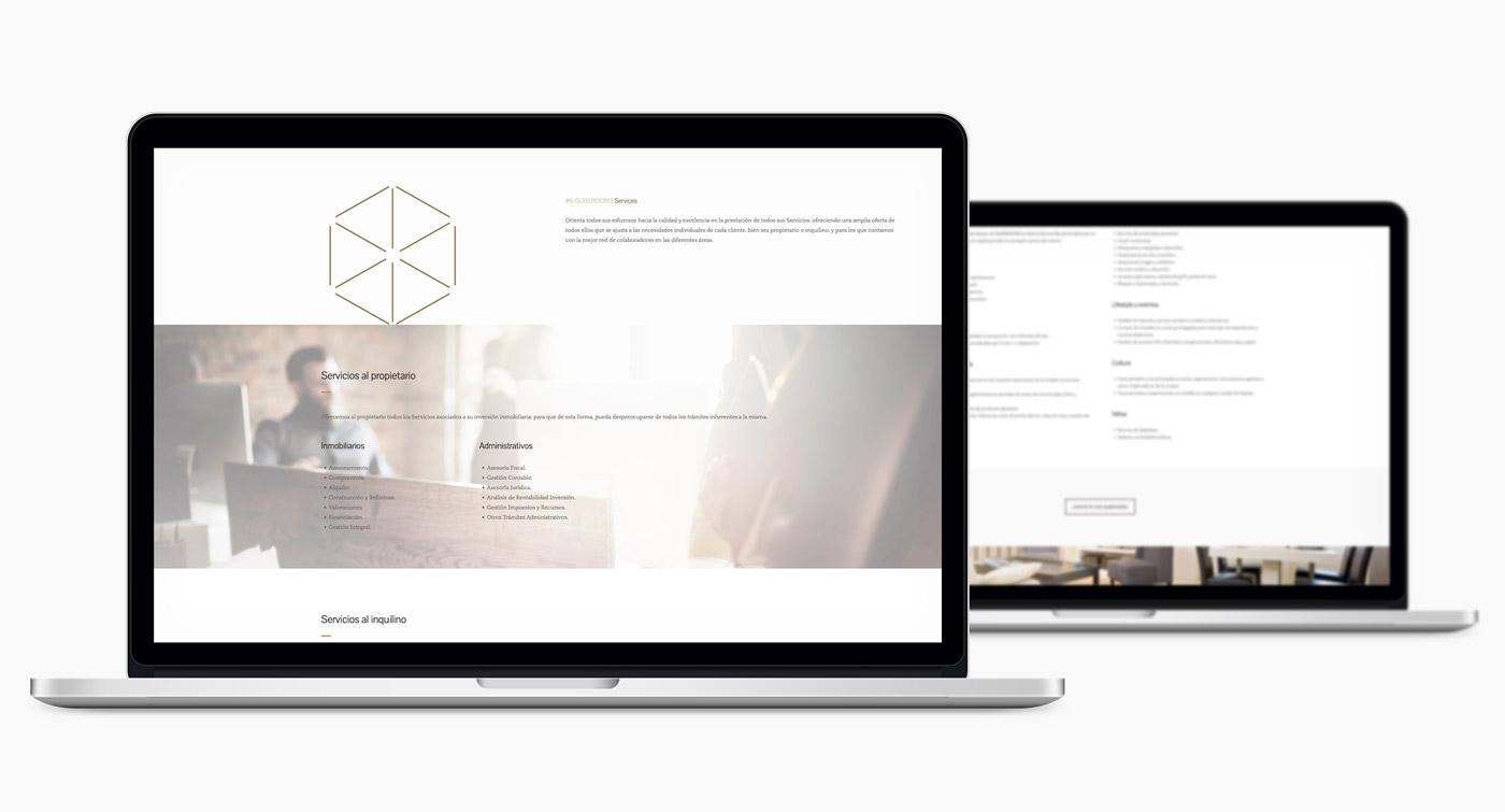 Diseno de web para QubeRooms presentación de diseño en 2 laptops
